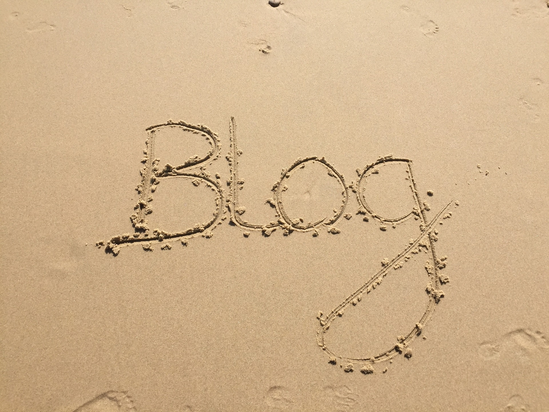 Is Blogging Dying? The word blog written in the sand.