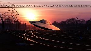 An alien flying saucer following the path of railway tracks with a sunset on the horizon